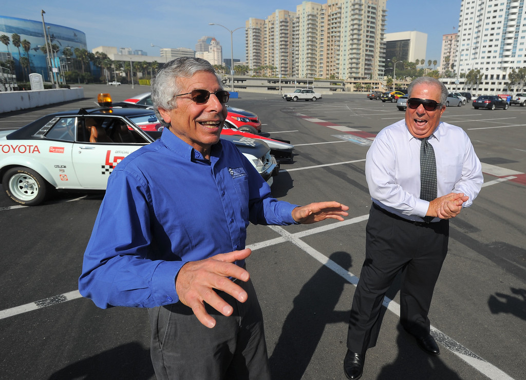 . Mayor Bob Foster, right, and Grand Prix Association of Long Beach President & CEO Jim Michaelian share a laugh as they kick off the first full day of LBGP track construction in Long Beach, CA on Tuesday, February 11, 2014. Foster and Michaelian pulled up to the event in a 1975 and 2014 Toyota pace cars. The 40th anniversary of the race with take place April 11-13 on the 1.97-mile course. (Photo by Scott Varley, Daily Breeze)