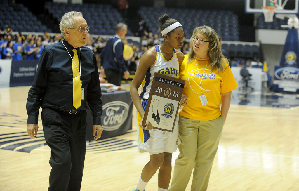 . 02-27-2012--(LANG Staff Photo by Sean Hiller)- Agoura defeated Gahr 60-39 in Wednesday\'s girls basketball D3AAA title game at Anaheim Arena. Gahr\'s Coach Al Dorogusker, left, and Jewelyn Sawyer (3) receive the second place plaque.
