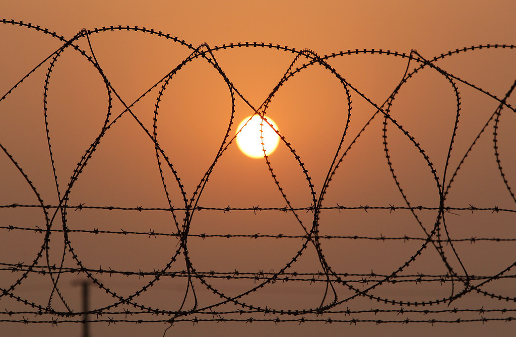 . PAJU, SOUTH KOREA - APRIL 04:  A barbed wire fence at the military check point, near the Demilitarized zone (DMZ) separates South and North Korea on April 4, 2013 in Paju, South Korea. 400 South Koreans remain in the joint industrial complex fearing they can not get back there once return to South. In recent weeks North Korea have threatened to attack South Korea and U.S. military bases.  (Photo by Chung Sung-Jun/Getty Images)