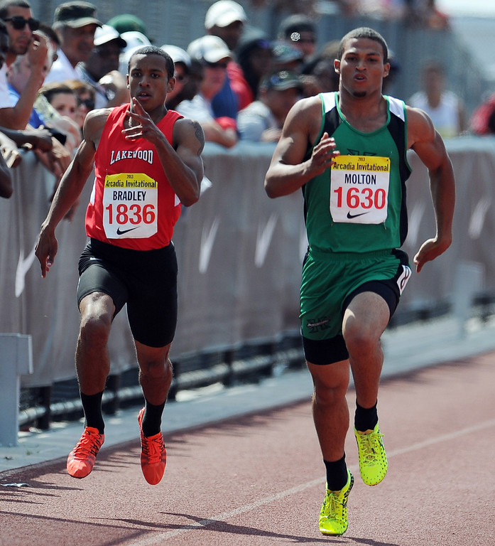 Description of . Lakewood's Amir Bradley, left, along with Hilltop's Donald Molton competes in the 200 meters race in the during the Arcadia Invitational at Arcadia High School on Saturday, April 6, 2013 in Arcadia, Calif.  (Keith Birmingham Pasadena Star-News)