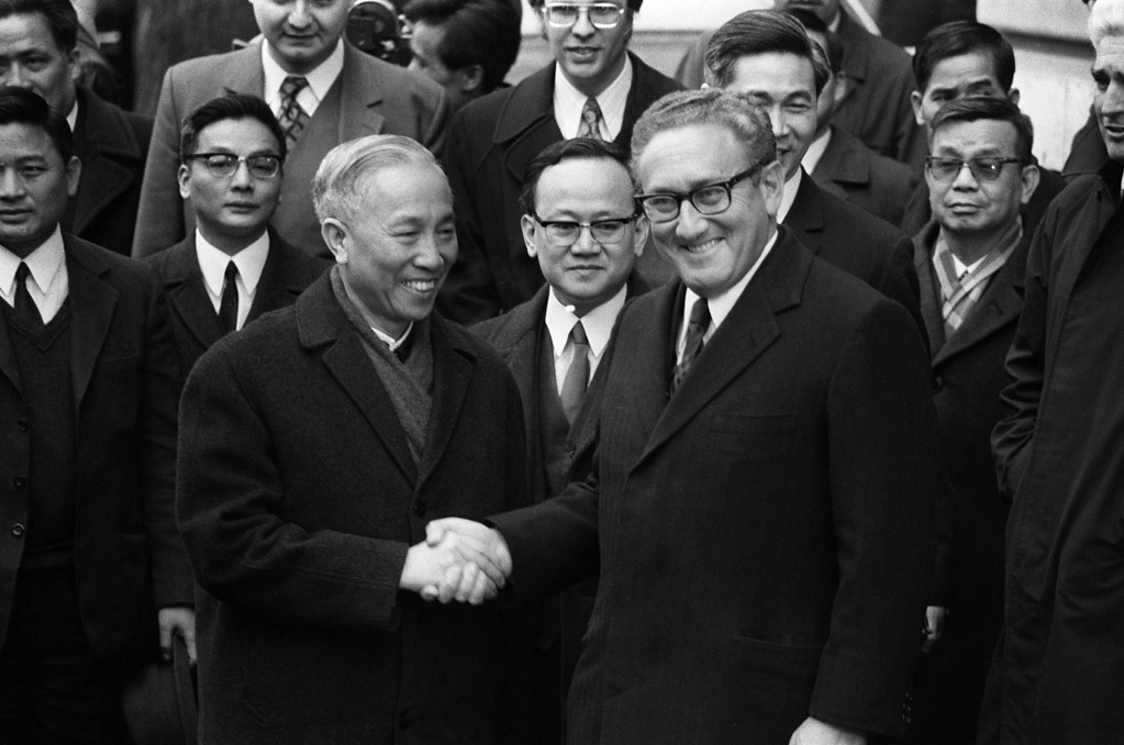 Description of . PARIS, FRANCE - JANUARY 23, 1973:  US National Security Adviser Henry Kissinger (R) shakes hand with Le Duc Tho, leader of North Vietnam delegation, after the signing of the Paris Peace Accords on 23 January 1973 in Paris, France. (Photo by AFP/Getty Images)