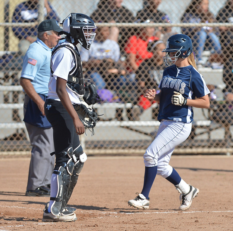 . 0314_SPT_TDB_L_CAR-NORTH--- Torrance, CALIFORNIA--3/13/13--- Staff Photo: Robert Casillas / LANG--- Carson at North Torrance softball. Megan Ottino comes in to score on hit by Tessa Tomaselli as Carson catcher Hillary Edior stands by.