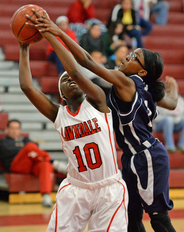. Lawndale\'s Zyaire Nelson (10) shoots against Leuzinger\'s Cheyenne Tannan (1) in a girls basketball game at Lawndale High Tuesday, December 10, 2013, in Lawndale, CA.  Photo by Steve McCrank/DailyBreeze