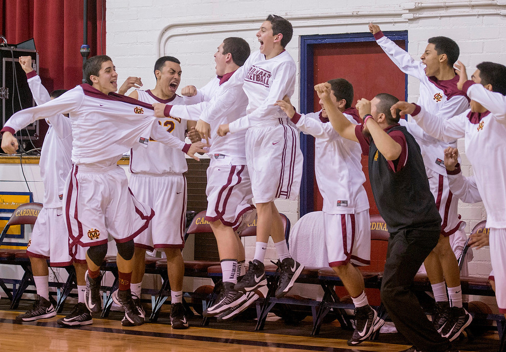Description of . The Cantwell Sacred Heart High bench erupts after their 62-58 win vs St. Anthony High boys basketball at Cantwell's Montebello campus gym Feb. 19, 2013.   (SGVN/Staff photo by Leo Jarzomb)