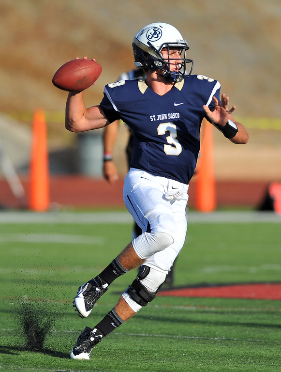 . St. John Bosco football takes on Chandler, Airzona as part of the Mission Viejo Classic in Mission Viejo, CA on Saturday, September 14, 2013. St. John Bosco won 52-31.  Bosco QB Josh Rosen fires a pass on the run. (Photo by Scott Varley, Press-Telegram)