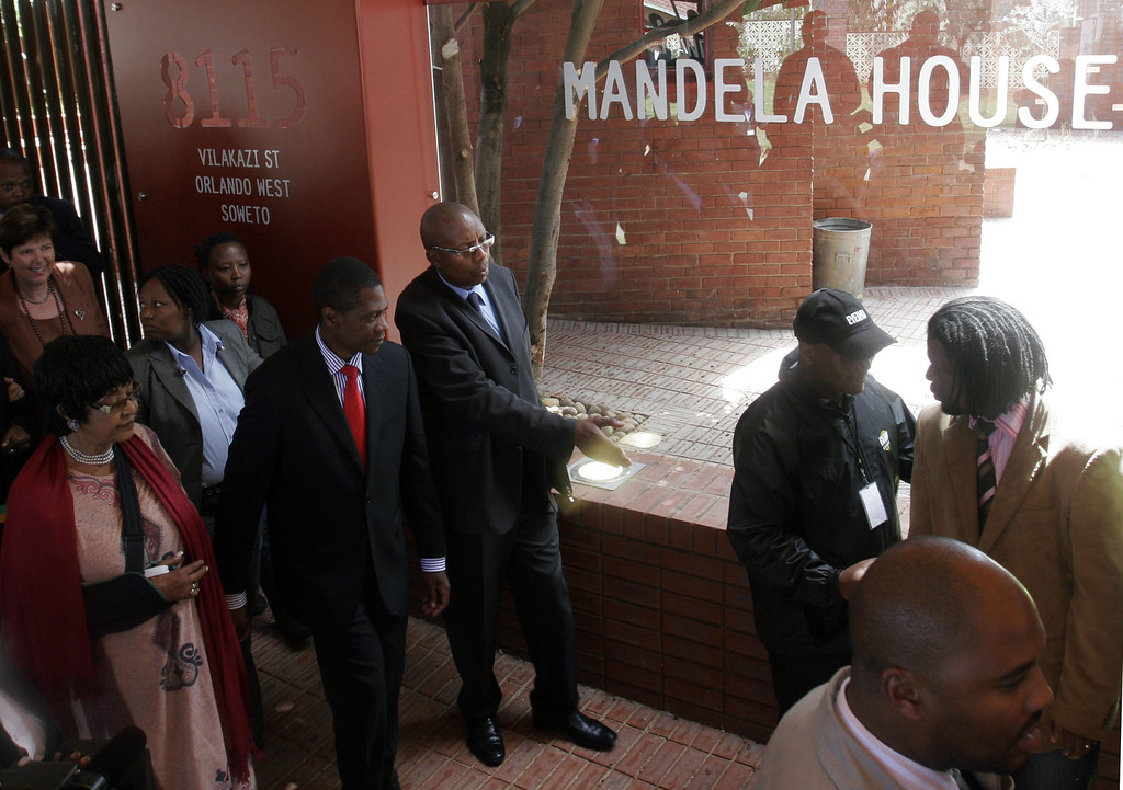 . Winnie Madikizela-Mandela, left, former wife of former president Nelson Mandela, and Gauteng Premier, Paul Mashatile, second left, tour Mandela House, in Soweto, South Africa, Thursday, March 19, 2009. The humble Soweto house that was home to Mandela,  has been transformed into a museum celebrating the life of the country\'s first black president.  (AP Photo/Denis Farrell)