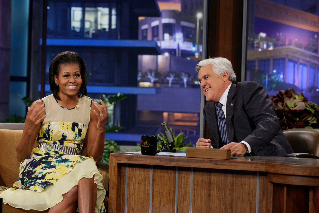 ". This Monday, Aug. 13, 2012 photo released by NBC shows first lady Michelle Obama, left, and host Jay Leno during a taping of ""The Tonight Show with Jay Leno,\"" in Burbank, Calif. (AP Photo/NBC, Margaret Norton)"