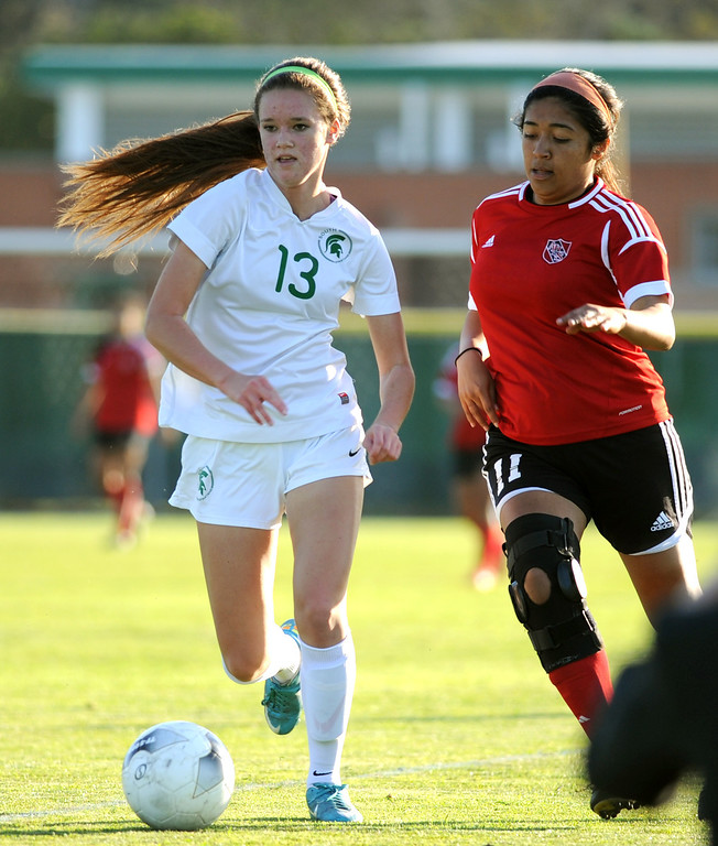 . 02-21-2012--(LANG Staff Photo by Sean Hiller)- South Torrance girls soccer beat Artesia 5-0 in Thursday\'s CIF Southern Section Division IV quarterfinal at South High.South\'s Korie Bozart (13) battles Arteisa\'s Nataly Haro (11).