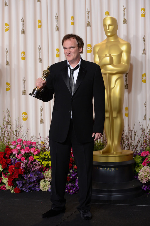 ". Quentin Tarantino accepts the award for best original screenplay for ""Django Unchained\"" backstage at the 85th Academy Awards at the Dolby Theatre in Los Angeles, California on Sunday Feb. 24, 2013 ( David Crane, staff photographer)"