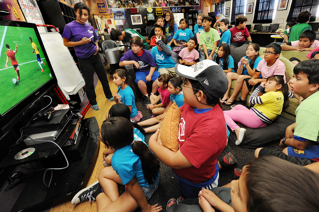 . Kids enjoy watching the World Cup soccer game between Brazil and Mexico at Boys & Girls Club of East Los Angeles at 324 MCDonnell Avenue in Los Angeles, Tuesday, June3 17, 2014. Mexico tied Brazil 0-0 in the game.(Photo by Walt Mancini/Pasadena Star-News)