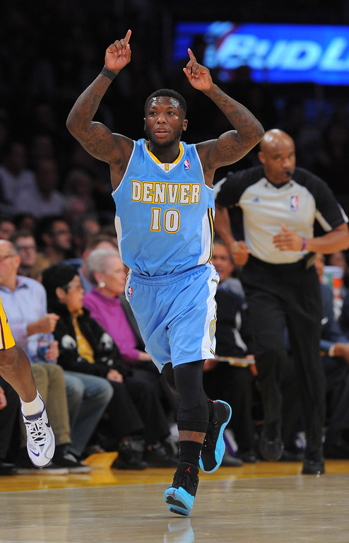 . Nuggets\' Nate Robinson celebrates a 3-pointer vs the Lakers at the Staple Center in Los Angeles, CA on Sunday, January 5, 2014. 1st half.  (Photo by Scott Varley, Daily Breeze)