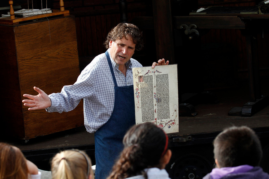 ". Mark Barbour, Executive Director and Curator of the International Printing Museum, gives a history leason on books and printing before Gutenberg to Benjamin Franklin\'s, using his ""Museum on Wheels\"" presented to the fifth grade class, at St. Marks Luthern School, in Hacienda Heights, Thursday, March 28, 2013. (Correspondent Photo by James Carbone/HIGH)"