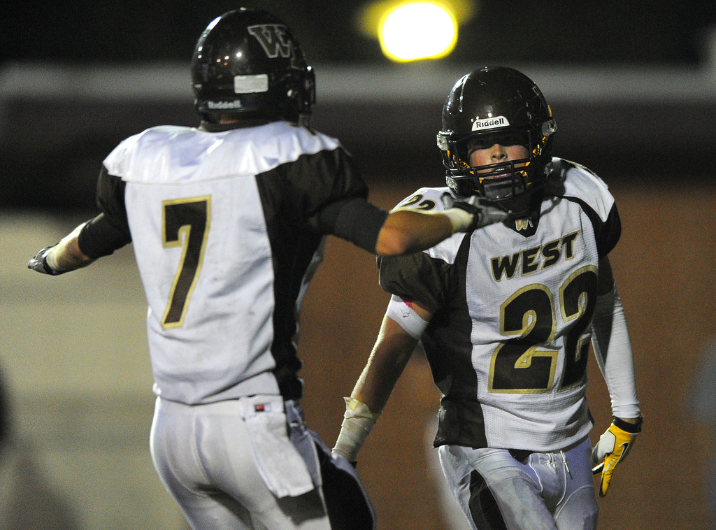 . West High takes on Torrance in a non league football game at Zamperini Stadium in Torrance, CA on Thursday, September 12, 2013. West\'s Kurtis Guelff (7) celebrates after #22 scored. (Photo by Scott Varley, Daily Breeze)