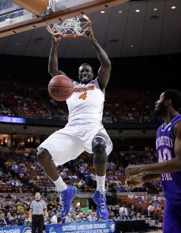 . Florida\'s Patric Young (4) scores in front of Northwestern State\'s Marvin Frazier, right, during the first half of a second-round game of the NCAA men\'s college basketball tournament Friday, March 22, 2013, in Austin, Texas.  (AP Photo/David J. Phillip)