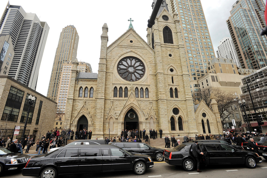 . Mourners leave Holy Name Cathedral after film critic Roger Ebert\'s funeral in Chicago, April 8, 2013. The Pulitzer Prize winning movie reviewer died Thursday, April 4 at age 70 after a long battle with cancer. (AP Photo/Paul Beaty)