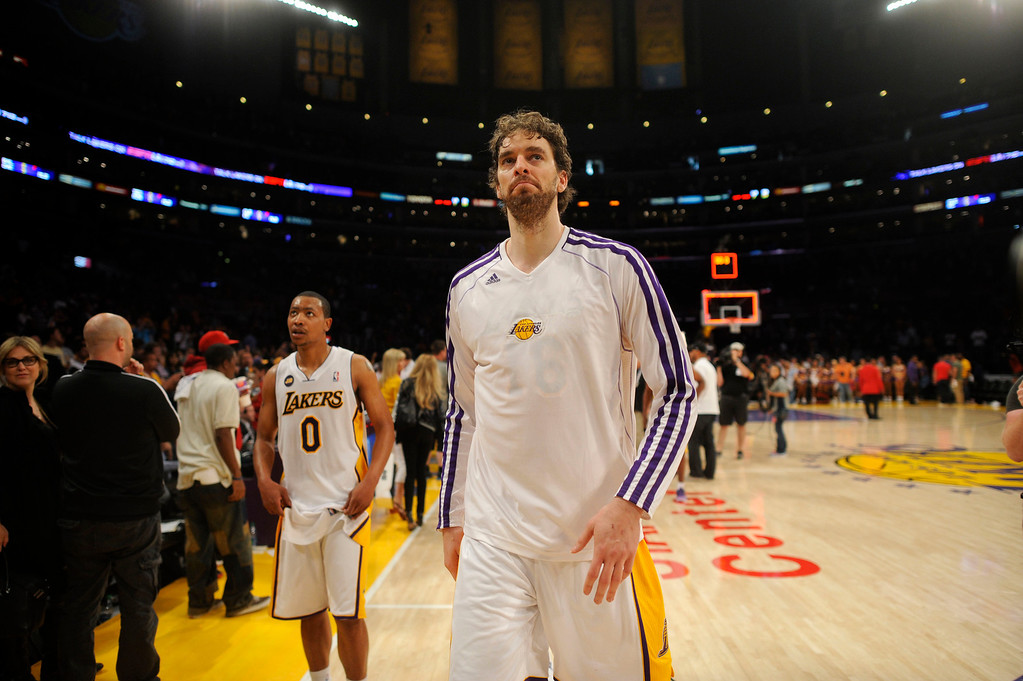 . Lakers\' Pau Gasol #16 and Andrew Goudelock #0  walk to the locker room after game four of their NBA Western Conference playoffs at the Staples Center Saturday, April 28, 2013. The Spurs beat the Lakers 120-89. The Spurs beat the Lakers 103-82. (Hans Gutknecht/Staff Photographer)