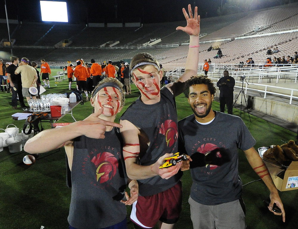 . Pasadena City College Students, Dante Brinoccoli, left, Paul Ingram, center, Kailyn Taylor show -off their lego car during the the 2013 Collegiate Field Tournament at the Rose Bowl on Friday, April 5, 2013 in Pasadena, Calif.  (Keith Birmingham Pasadena Star-News)