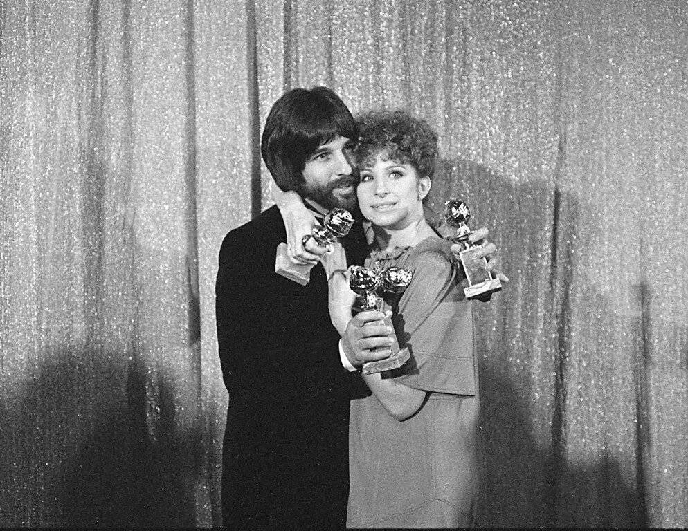 ". Jon Peters and Barbra Streisand hold their awards at the Golden Globe Awards in Hollywood, Jan. 29, 1977.  They won four awards for ""A Star Is Born.\""  (AP Photo)"