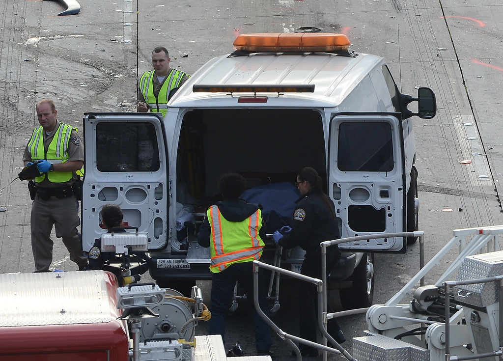 . LA coroner on the scene were 2 people were killed on the west 118 freeway at White Oak early Monday morning. The crash involved 2 cars and a semi truck with one car bursting into flames. All the lanes were shut down on the west bound side for 5hrs and the freeway open back up at 9am. Granada Hills CA. April 1,2013 PHOTO BY Gene Blevins/LA DailyNews
