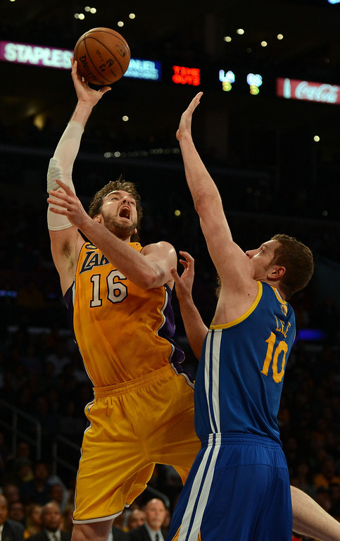 . The Lakers\' Pau Gasol #16 shoots as the Warriors\' David Lee #10 defends during their game at the Staples Center in Los Angeles Friday, April 12, 2013. (Hans Gutknecht/Staff Photographer)