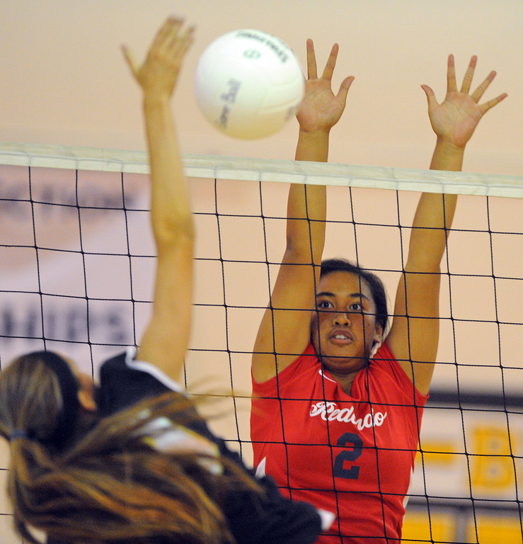 . Redondo girls volleyball takes on Bishop Montgomery in a non league match in Torrance on 09/10/2013. Redondo won 3-0. Bishop\'s Tessa Allen, left, has her spike blocked at the net by Norene Iosia. (Photo by Scott Varley, Daily Breeze)