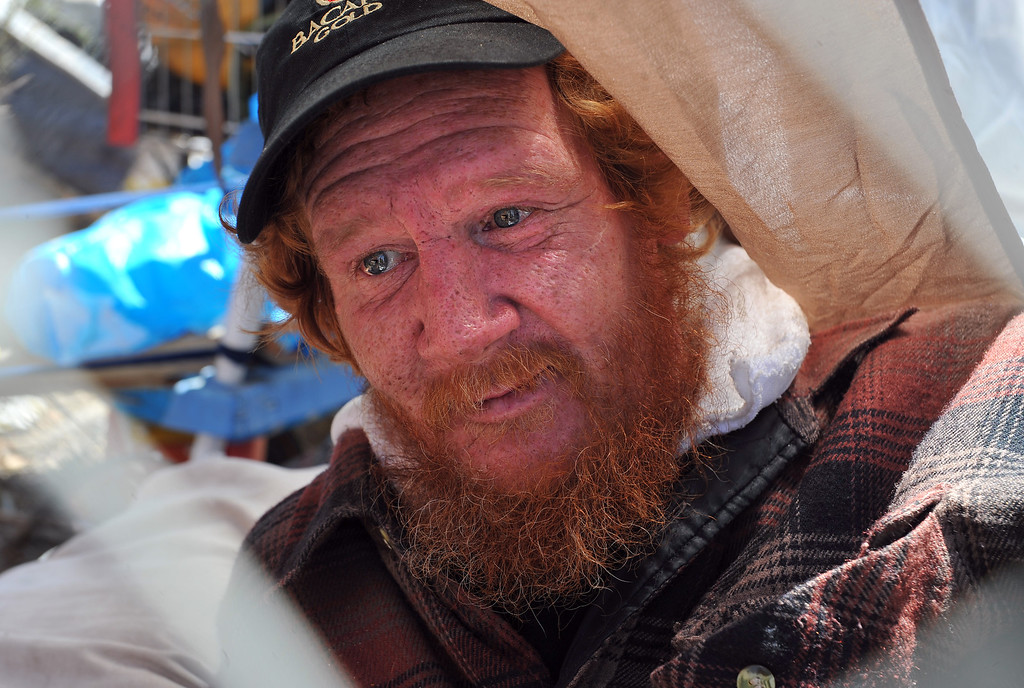 """. 8/5/13 - Ronald Duane \""""Rocky\"""" McMenamy Jr. has been homeless for 26 years. He is terminally ill with cirrhosis of the liver. Given 6 months to live in 2009 he has beaten the odds buts admits to daily drinking and drug use. Rocky has spent most of his homeless life in Long Beach in encampments along the LA Riverbed ad the 710 Freeway. After a recent evacuation he finds himself living at the 710 and Artesia Boulevard, home to roughly 23 people. The area is not as populated as years past but those facing chronic homelessness can still be found living under the bridges and in encampments. The county cleaned out the area in March 2013 and has stayed on top of the brush clearance and clean-up. Photo by Brittany Murray / Staff Photographer"""