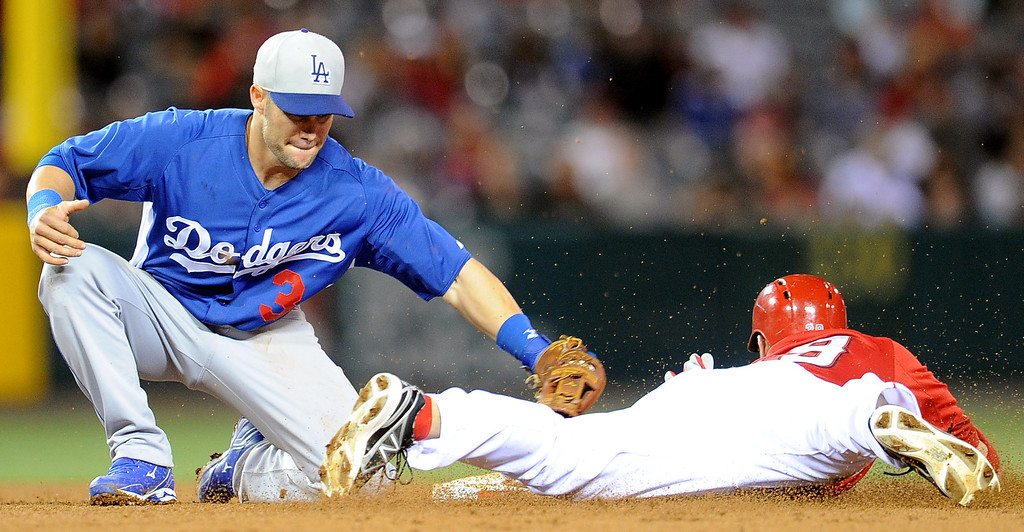 . Los Angeles Angels\' J.B. Shuck (39) steals second base ahead of the tag by Los Angeles Dodgers second baseman Skip Schumaker (3) in the eighth inning of a spring baseball game on Thursday, March 28, 2012 in Anaheim, Calif.   (Keith Birmingham/Pasadena Star-News)