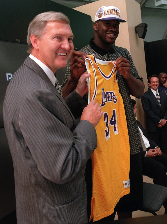 . Dream Team member Shaquille O\'Neal holds up his Los Angeles Lakers jersey with General Manager Jerry West Thursday July 18, 1996 in Atlanta. O Neal signed a seven-year, $120 million contract with the Los Angeles Lakers Thursday, the Dream Team s first full day at the Olympics. (AP Photo/Hans Deryk)