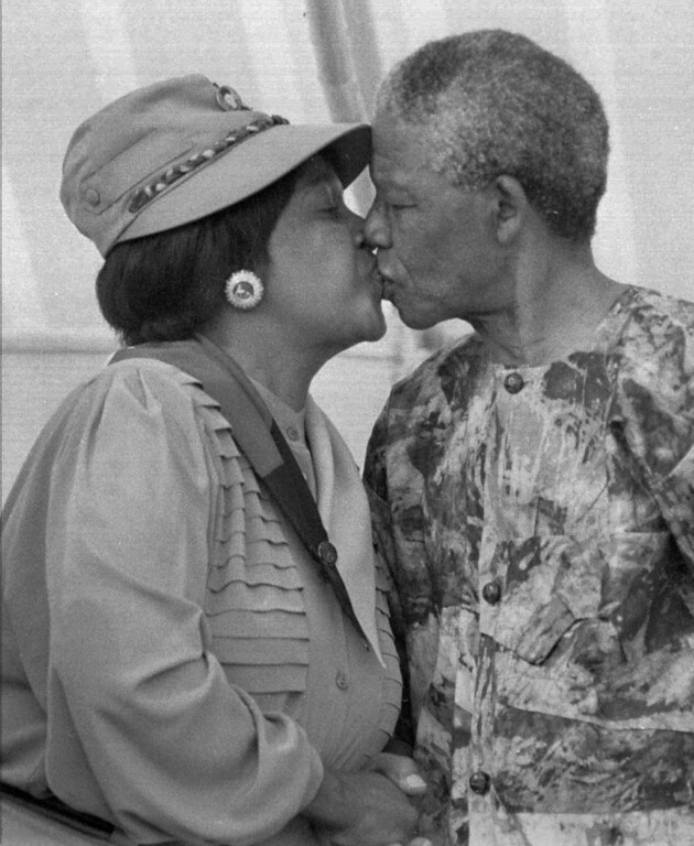 . South African president Nelson Mandela kisses his wife Winnie Mandela at a rally in Cape Town in early 1993. Local radio reported Thursday Aug.17 1995 that Nelson Mandela had hired a lawyer to institute divorce proceedings against his wife. (AP PHOTO/BENNY GOOL)