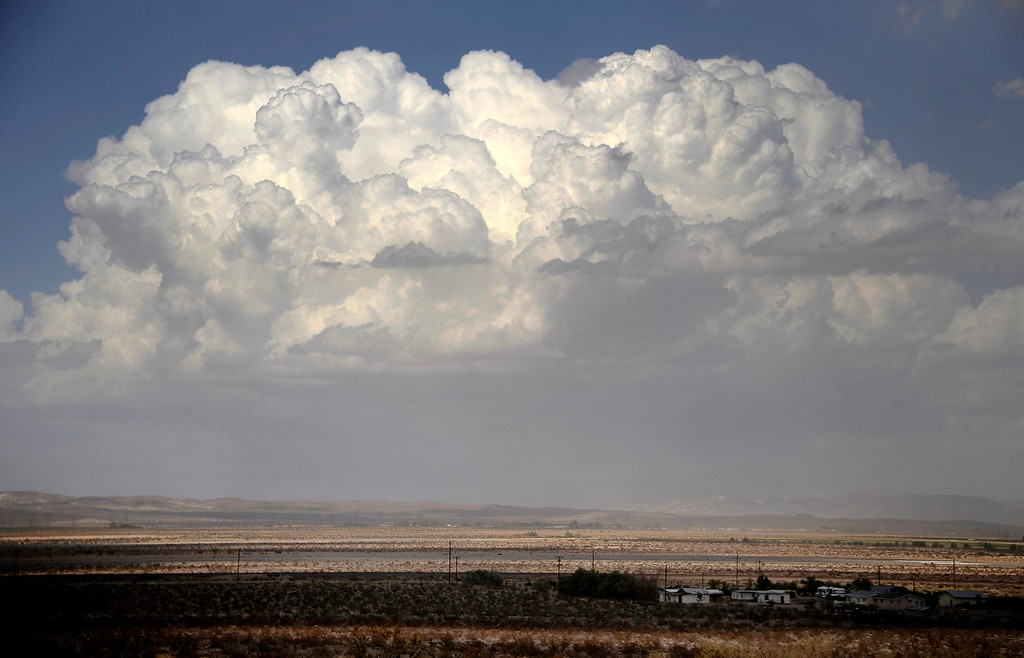 . Huge monsoon storm clouds form over Barstow CA in the high deserts today Sunday. Aug 25,2013. Photo by Gene Blevins/LA Daily News