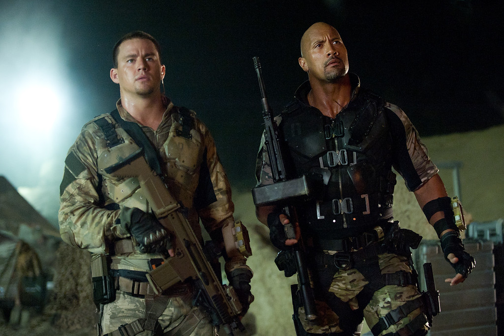 ". This film image released by Paramount Pictures shows Channing Tatum, left, and Dwayne Johnson in a scene from ""G.I. Joe: Retaliation.\"" (AP Photo/Paramount Pictures, Jaimie Trueblood)"