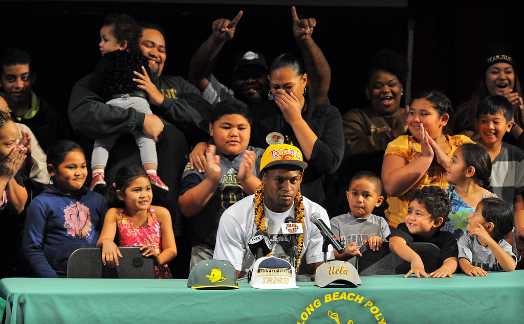 """. In front of a national television audience and surrounded by his large family, Long Beach Poly football player John \""""JuJu\"""" Smith announces that he will play football for USC during a ceremony at Poly in Long Beach, CA on Wednesday, February 5, 2014. (Photo by Scott Varley, Daily Breeze)"""