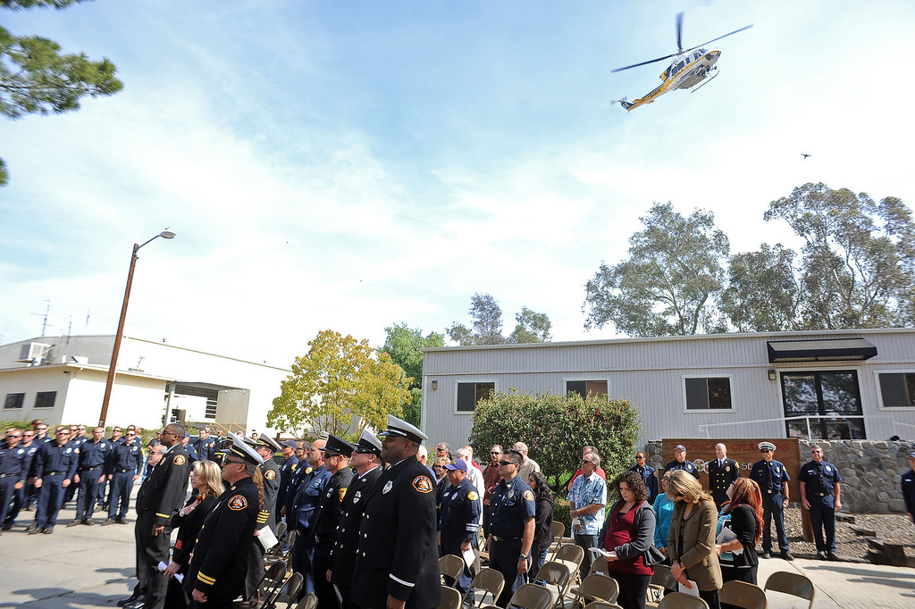. A fire helicopter performs a flyover during the 20th Anniversary Memorial Ceremony for firefighter Jeff Langley March 28, 2013 at the Los Angeles County Fire Department Barton Heliport in Pacoima, CA.  Langley was killed during a 1993 Air Operations rescue in Malibu.(Andy Holzman/Staff Photographer)