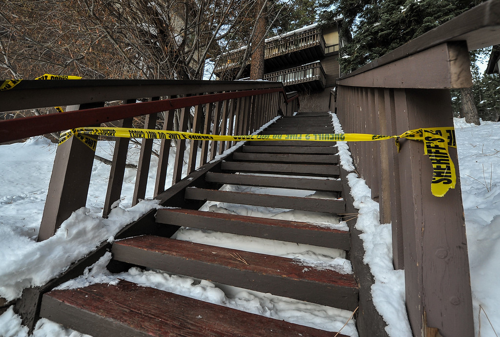 . Sheriff\'s crime scene tape blocks access to a condo where fugitive ex-cop Christopher Dorner allegedly stayed for an unknown time while multiple law enforcement agencies searched the mountain area in Big Bear on Wednesday, Feb. 13, 2013. The Sheriff\'s command post near Bear Mountain Resort was established directly across the street from the condo. (Rachel Luna / Staff Photographer)