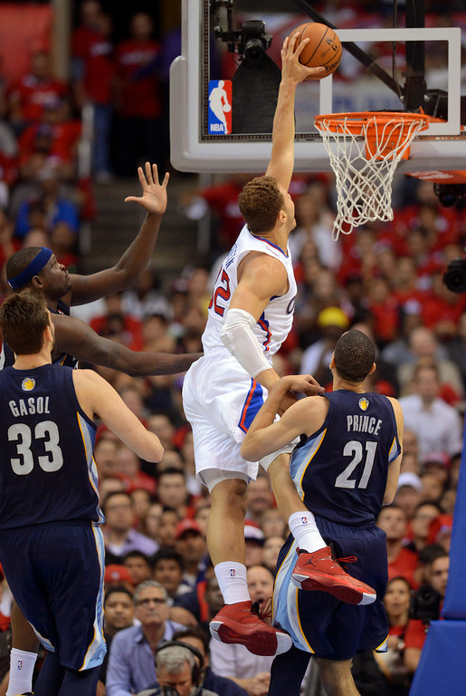 . Clippers forward Blake Griffin throws down a dunk against the Memphis Grizzlies during game 2 of the 2013 NBA Western Conference Playoffs April 22, 2013 in Los Angeles, CA.(Andy Holzman/Staff Photographer)