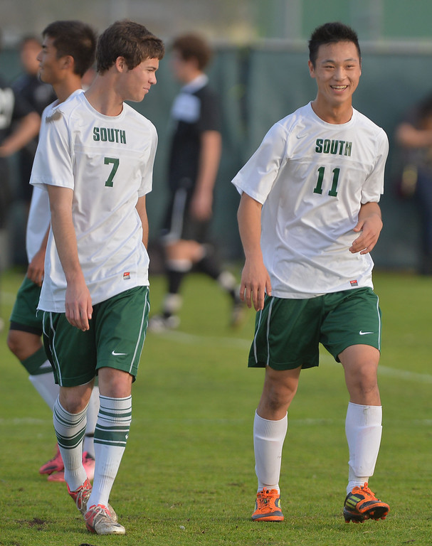 . TS16-BISHOP-SOUTH--- Torrance, CALIFORNIA--2/15/13--- Staff Photo: Robert Casillas / LANG--- Bishop Montgomery lost to host South Torrance 2-1 in CIF Div IV boys soccer playoff game. Ryosuke Inaba (11) is all smile as he leaves field with Matt Michell.