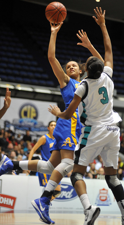 Description of . Bishop Amat's Mauriana Clayton (#23) turns to make a shot as they play Canyon Springs in the CIF-SS Division 1A girls basketball finals at the Anaheim Arena on Friday February 28, 2013. Canyon Springs beat Bishop Amat 48-46. (SGVN/Staff Photo by Keith Durflinger)