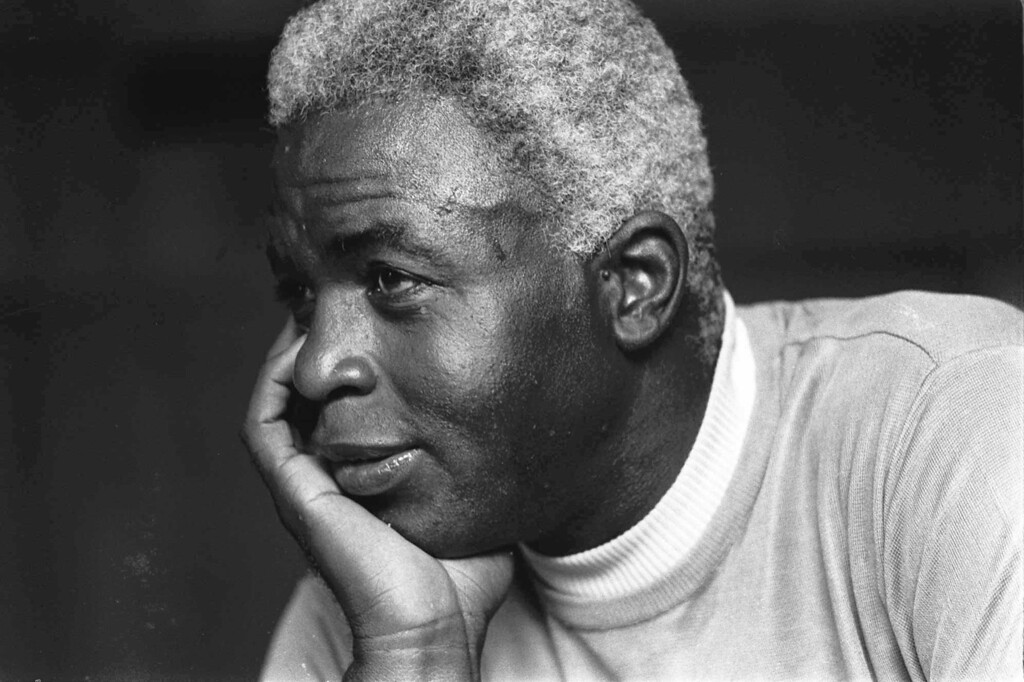 "Description of . FILE - In this June 30, 1971 file photo,  Jackie Robinson poses at his home in Stamford, Conn. Kansas City\'s Negro Leagues Baseball Museum is hosting an advance screening of an upcoming movie about Robinson, who broke major league baseball\'s color barrier. Thomas Butch of the financial firm Waddell and Reed announced Wednesday, March 20, 2013 that actors Harrison Ford and Andre Holland will be among those appearing at an April 11 screening of ""42.\""   (AP Photo/File)"