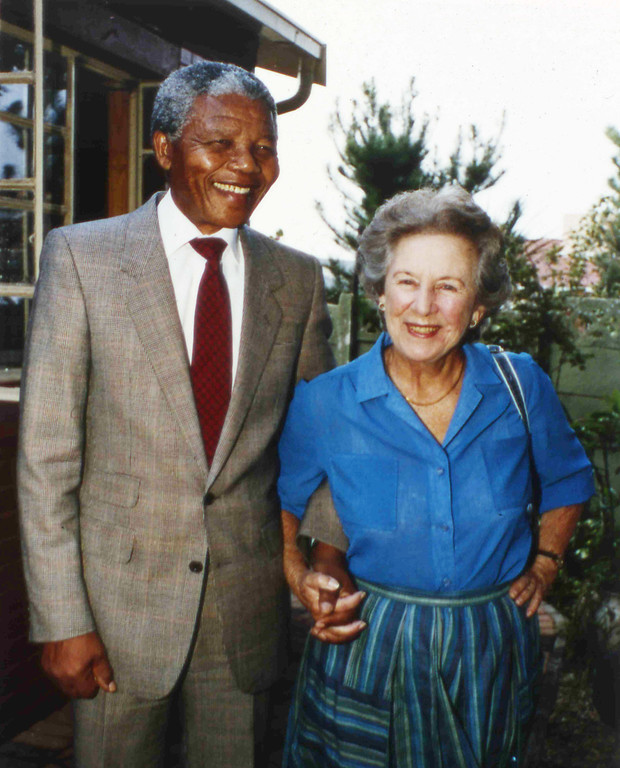 . Veteran anti-apartheid ex-member of Parliament, Helen Suzman, right, holds hands with recently released ANC leader Nelson Mandela, when Suzman visited Mandela at his Soweto home, Feb. 26, 1990. (AP Photo/John Parkin)