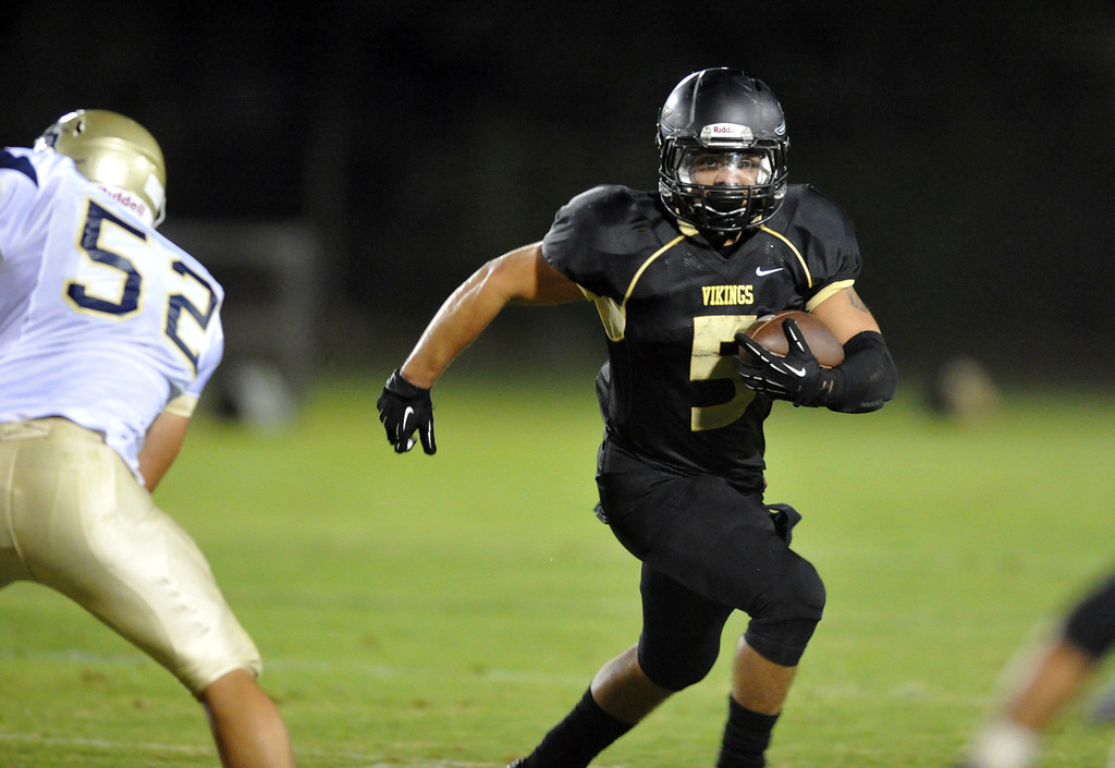 Description of . Northview's Bryan Salinas (#5) runs around a Rowland defender in their non-league game at Covina District Field in Covina on Friday September 13, 2013.  (San Gabriel Valley Tribune/Staff Photo by Keith Durflinger)