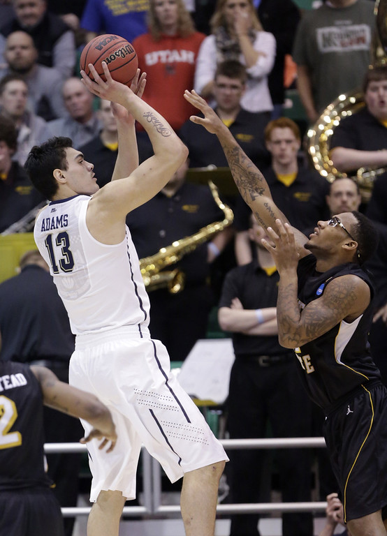 . Pittsburgh\'s Steven Adams (13) shoots as Wichita State\'s Carl Hall (22) defends in the first half during a second round game in the NCAA college basketball tournament in Salt Lake City Thursday, March 21, 2013. (AP Photo/Rick Bowmer)