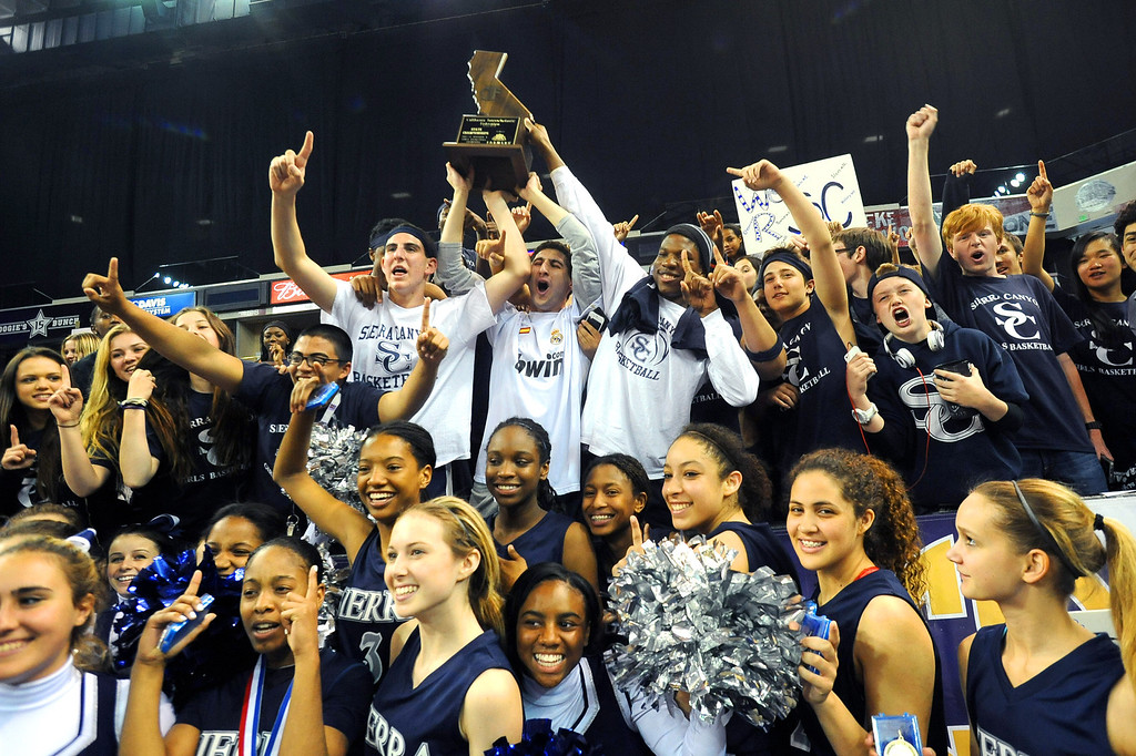 . Sierra Canyon High School players and fans hoist the State Championship trophy after they defeated Pinewood 47-33 during the 2013 CIF State Basketball Championships at the Sleep Train Arena, in Sacramento, Ca March 22, 2013.(Andy Holzman/Los Angeles Daily News)
