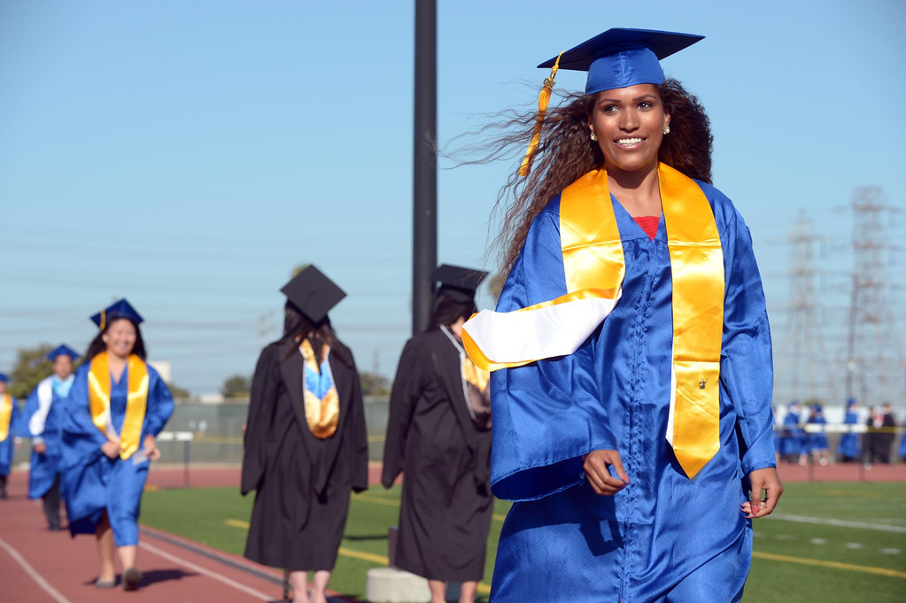 . Sara Marie Valdez walks to receive her diploma. The 2013 North High School commencement ceremonies take place on the school\'s football field in Torrance Wednesday afternoon.