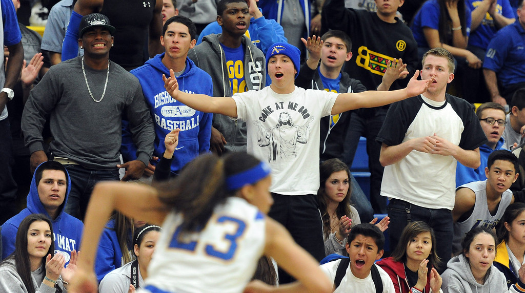 Description of . Bishop Amat fans upset in the second half of a CIF State Southern California Regional semifinal basketball game against Long Beach Poly at Bishop Amat High School on Tuesday, March 12, 2013 in La Puente, Calif. Long Beach Poly won 52-34.  (Keith Birmingham Pasadena Star-News)