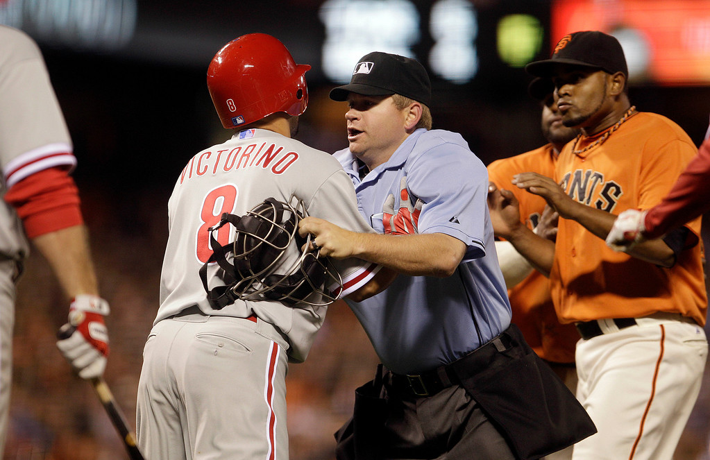 . Philadelphia Phillies\' Shane Victorino, left, is restrained by home plate umpire Mike Muchlinski, after Victorino was hit by a pitch thrown by San Francisco Giants\' Ramon Ramirez, right, during the inning of a baseball game Friday, Aug. 5, 2011, in San Francisco. The altercation caused a benches clearing brawl. (AP Photo/Ben Margot)