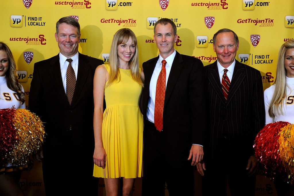 . USC\'s new men�s basketball coach Andy Enfield, second from right, stands with with his wife Amanda Marcum Enfield and Steve Lopes, left, USC\'s COO and CFO of the athletic department, and Pat Haden, USC athletic director following a press conference at Galen Center, Wednesday, April 3, 2013. (Michael Owen Baker/Staff Photographer)