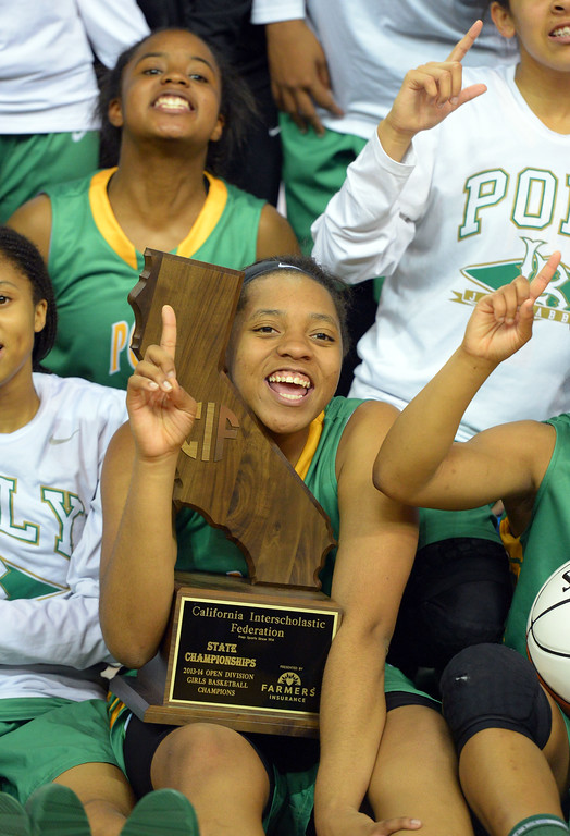 . Poly\'s Jada Matthews holds their championship state trophy during the team photo at Sleep Train Arena in Sacramento, CA on Saturday, March 29, 2014. Long Beach Poly vs Salesian in the CIF Open Div girls basketball state final. 2nd half. Poly won 70-52. (Photo by Scott Varley, Daily Breeze)