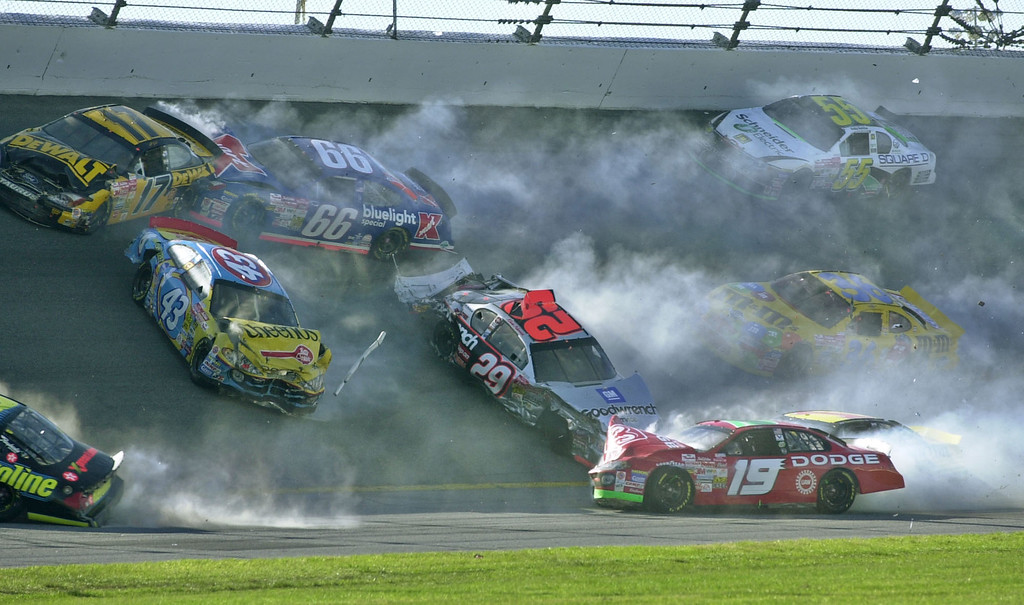 . Nine of the 17 cars involved in the Daytona 500 crash in turn 2 slide around the track at Daytona International Speedway in Daytona Beach, Fla., Sunday, Feb. 17, 2002.  Shown are Matt Kenseth (17), Todd Bodine (66), John Andretti (43), Kevin Harvick (29), Jeremy Mayfield (19), Kenny Schrader (36), Bobby Hamilton (55) and Kenny Wallace (1), bottom right. (AP Photo/Phil Manson)