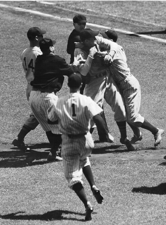 . Manager Job Cronin, left, of the Boston Red Sox and outfielder Jake Powell follow of the Yankees are shown locked in combat during the fourth inning of the first game of a doubleheader in  New York, May 30, 1938. Other players try to separate them.  Pitcher Archie McKain of Boston moves in; Art Fletcher, in jacket, Yank coach, tugs at Cronin, and Frank Crosetti runs forward. The fight grew out of Powell?s being hit with a pitched ball by McKain. Both Cronin and Powell were banished from the game. (AP Photo)