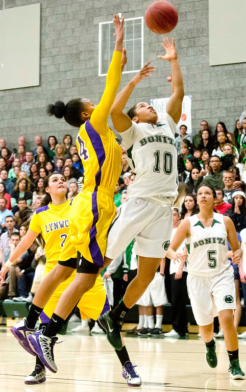 Description of . Bonita's Nikki Wheatley (10) goes up for basket against Lynwood's Alize Losfton (14) in the second half of Bonita vs Lynwood CIF-SS Divisions 2AA girls basketball semifinals at Bonita High School in La Verne on Tuesday evening, Feb. 26, 2013. Lynwood won 60-47. (SGVN/Staff photo by Watchara Phomicinda)